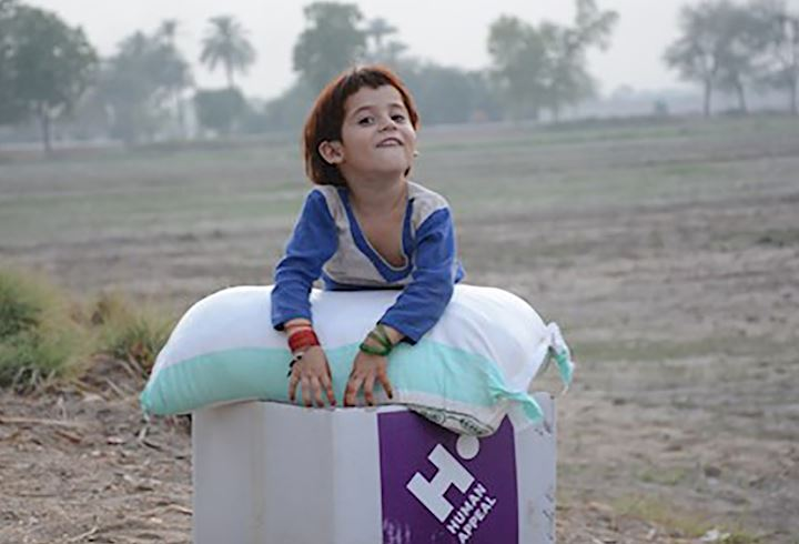 small child on a human appeal food parcel